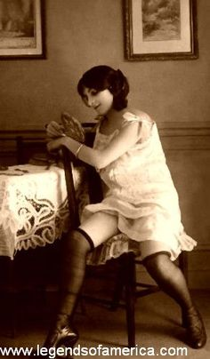 Common prostitution image of the time - white chemise with black stockings