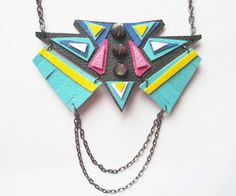 Tribal carnival meets colourful geometric in this bold, bright, fun Laroca Tribe necklace.  Hand-cut, both faux and real leather in shades of blue