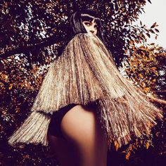 This glittery dress from Kylie Jenner's high fashion photoshoot is what sparkly gold dreams are made of