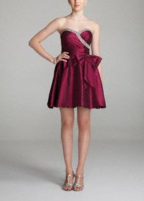 Dare to bring the drama as you dance the night away in this stunning Inspire Me dress!  This short and stylish homecoming dress features an eye catching sweetheart neckline with beaded trim.  Statement-making bow on waist adds texture and dimension.