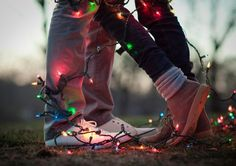 Winter is probably the only time you can actually find dollar store decor that will work as photo props. Work Christmas lights into your engagement shoot for a fun festive image.    Photo by  A Sunshine Moment .