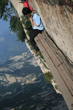 Mount Huashan, China.  One of the mountainside board ledges - my stomach churns just looking at this.