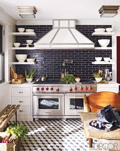 Graphic pops of black, white, and gray invigorate the kitchen of an 1890s house in Southampton, New York, decorated by Steven Gambrel.