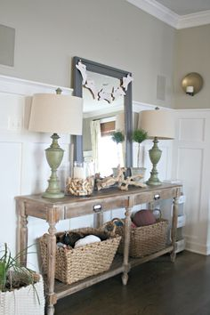 Decorating a foyer or hall table - glass vase, wine corks & candle
