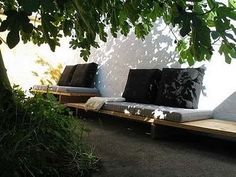 Benches along a wall. Repinned by www.claudiadeyongdesigns.com and at www.thegardenspot.co.uk