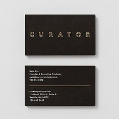 Uncoated black business card with gold and white foil