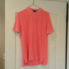 Boys bright coral polo shirt Boys bright coral Polo shirt with lime green polo insignia Polo by Ralph Lauren Other