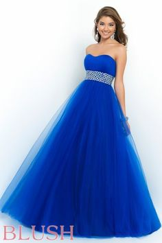 This  style is simple but perfect for every figure and all formal events. This universal gown features a strapless semi sweetheart neckline ,beaded waistband, and full tulle skirt. Back zipper closure. Available in Cobalt, Bittersweet, and French Rose