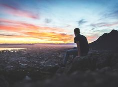 Man sitting on a rocky ledge, watching the sunset over Cape Town Man Images, Free Images, California Condor, Eyes On The Prize, Tough Love, Guy Pictures, Image Hd, Christianity, South Africa