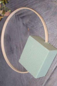 Poke an embroidery hoop through foam to copy her front door (cute!)