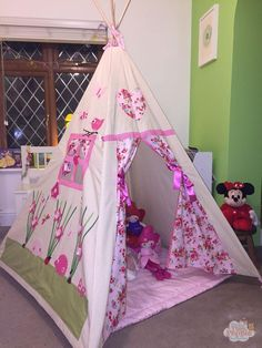 A teepee is a wonderful hideaway, which becomes an imaginative world of play for your tiny person.|Designed and Handmade in the UK. All fabrics chosen are hand picked to ensure many magical adventures for years to come.|Sizes: Magical Teepees are 145 cm tall and 120 x 120 cm at the base. Midi Teepees are 100 cm tall and 95 x 95 cm at the base.|It is super easy to set up a teepee. Set the poles apart and let playtime begin. You can squish a teepee together when not in use.|Within every teepee…