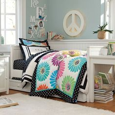 All she needs is the black and white duvet, and her room will be complete!  Flower Pop Quilt & Sham   PBteen