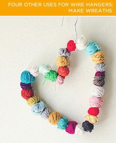 #DIY heart-shaped yarn wreaths with wire hangers.