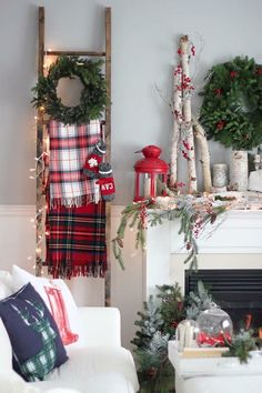 Cozy farmhouse style Christmas decorating ideas. Love the plaid blankets and the birch logs.