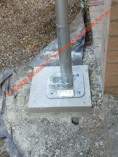 A close up view of the 8.5m high 250 kg mast sitting in a specially designed heavy duty gal steel tilt mast holder.  This footing is 1m deep, 1/2m Sq filled with steel bar reo and heavy duty concrete