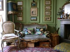 This is the Drawing room, painted in Farrow and Ball's Saxon Green. Or perhaps it is Cooking Apple green? The Italian sofa came from Christina's grandparents and they gave her the lovely damask covered chair for her eighteenth birthday. The standard lamp comes from Roger's family. Christina took the gold thread embroidery from another lamp shade and stuck it on this one.