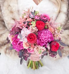 lush peonies in different shades of pink, red garden roses, ranunculus, stock, spray roses, astilbe + berry red seeded eucalyptus - Love Struck: Rustic Chic Valentine's Day Inspiration by Kristina Curtis Photography - via greenweddingshoes