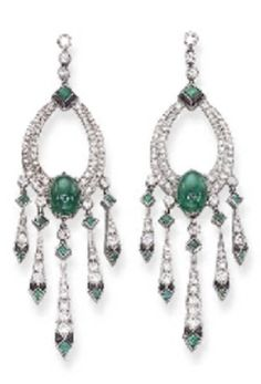A PAIR OF ART DECO EMERALD AND DIAMOND EAR PENDANTS, CIRCA 1928. Each designed as a circular-cut diamond tapered oval, set with a cabochon emerald, to the collet diamond and bezel-set emerald drops suspending a tapered diamond-set fringe with onyx and emerald geometric motif terminals. #ArtDeco #earrings