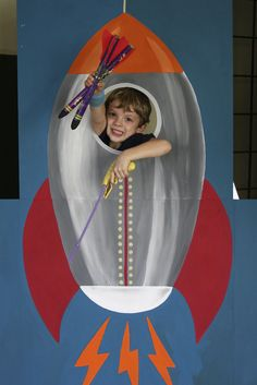 Photo Booth Rocket. I would make it horizontal so it looks like they're flying it.