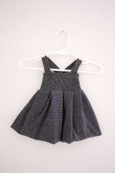 This blogger does an excellent job of showing how to sew a suspender dress from a T-shirt.