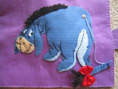 Eeyore needs help to pin his tail back
