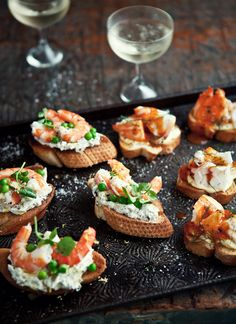 Fresh prawn crostini with caper, green olive, and goat's cheese paste, baby peas, and lemon oil by What Katie Ate.