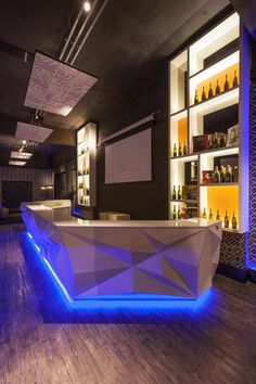 Bar counter with effect on its facade accompanied with blue lighting in the bottom giving it a floating effect Lounge Design, Bar Lounge, Design Hotel, Café Design, Bar Interior Design, Hookah Lounge, Paris Design, Design Ideas, Commercial Design