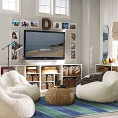 Upgrade your playroom and create a cool teen lounge room with furniture and decor from Pottery Barn Teen. Find inspiration and ideas for your teen's favorite hangout space. Room, Room Design, Family Room, Loft Playroom, Couch And Loveseat, Kids Tv Room, Home Decor, Lounge Room, Lounge Room Decorating Ideas