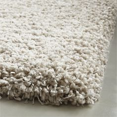 Shop Memphis 8x10 White Shag Rug.  The shag never skips a beat when re-choreographed in stain-resistant, colorfast polypropylene.  It has the same sink-in softness as wool, without the shedding.