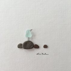 Mini pebble art picture comes matted and ready for you to frame in your own way. These small matted pictures ship easily, quickly and inexpensively around the world. See my listing for 5 by 5 frame and add it to your cart if youd like me to frame it for you. https://www.etsy.com/ca/listing/484704130/5-by-5-inch-mini-pic-frame-made-to-fit https://www.etsy.com Note that framing will increase the shipping costs as it can no longer be shipped in an envelope.