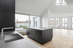 Kitchen w. stainless steel countertop & black MDF panels