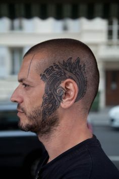 Not the biggest fan of tattoos on the head but this one looks really cool (photo from tumblr.com)