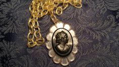 Hey, I found this really awesome Etsy listing at https://www.etsy.com/listing/189333276/neat-lucite-faux-cameo-w-celluloid-chain