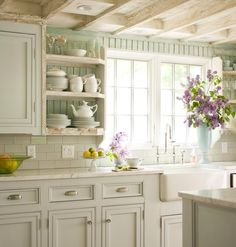 This beautiful kitchen has been in my inspiration files for years...the timeless elegance of marble complements so well the warmer, more rustic details... Don't you think? LOVE.IT.!