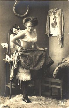 """A woman who worked as a prostitute in the American """"Old West,"""" flashing her elaborate undergarments for the camera."""