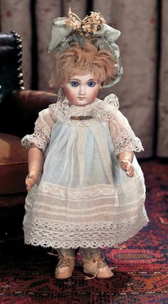 """Earliest Period Size 1 French Bisque Bebe E.J. Jumeau  10"""" (25 cm.) Marks: 1 E.J. (head) Jumeau Medaille d'Or Paris (body). Comments: Emile Jumeau,earliest period of the signature E.J. model,circa 1882,the model closely resembles the premiere bebe by that firm."""