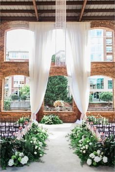 The prettiest wedding ceremony setup ever at Wyche Pavilion in Greenville! I love the greenery down the aisle and the scale of the altar draping!