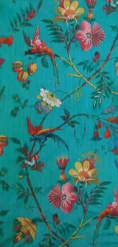Pretty wallpaper or cloth to make skirt or dress of whatever from..... Love that it's a turquoise color & flowers & birds speak to me of creation.....