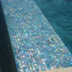 Iridescent Italian glass tile.  I want my bathroom done in this...and lots of it!!