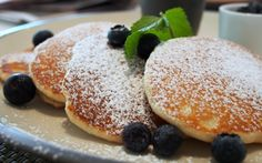 Sugar-dusted buttermilk pancakes with blueberries.  At Waterfall Cafe at Shangri-La Hotel, Singapore.