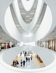 Helsinki University Library  The dramatic white interior of the University of Helsinki's new main library, by local firm Anttinen Oiva Architects, is striking for its curving travertine-marble staircase, its Finnish furnishings, and the oval-shaped voids the architects carved out of the center of the floor plates.