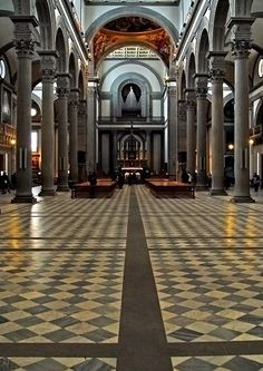 Basilica di San Lorenzo, a photo from Florence, Tuscany..The Basilica di San Lorenzo is one of the largest churches of Florence, Italy, situated at the centre of the city's main market district, and the burial place of all the principal members of the Medici family from Cosimo il Vecchio to Cosimo III.