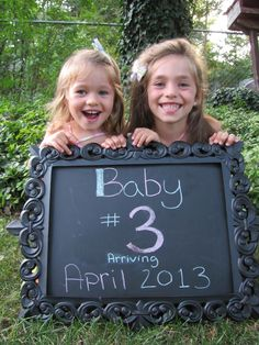 pregnancy announcement...have Journey hold u/s pic and Harli holding chalk?