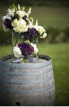 Wine Wedding Purple and White Flowers on a Wine Barrel.