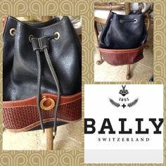 """Bally Italy vintage bucket shoulder bag. Has a few marks on brown leather see pictures. Saddle soap can be applied to the straps on aged leather. Gold tone metal hardware front logo plate. Lining black vinyl. Pull string top closure. large Bucket style black leather bag accented with brown hand woven leather. Adjustable Strap drop 16"""" 11""""height 12"""" wide Bally  Bags Shoulder Bags"""