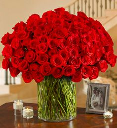 100 Premium Long Stem Red Roses in a Vase- Hand-designed in a clear glass vase for a touch of simple yet classic elegance $349.99