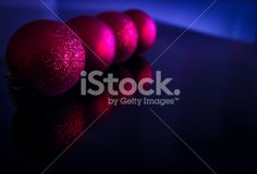 Fotografía Gema Ibarra: Red christmas balls by Gema Ibarra at Istock