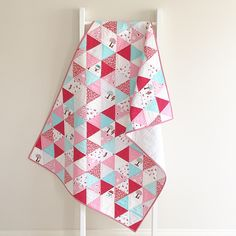 Beautiful triangle quilt featuring Little Red Riding Hood fabric designed by Tasha Noel for Riley Blake Designs