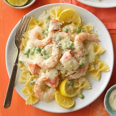 My guest can't believe I prepared this dish myself. This rich, creamy main dish features plenty of seafood flavors with a hint of garlic and lemon. Frozen peas and a jar of Alfredo sauce make it a simple supper that will be requested time and again.—Melissa Mosness, Loveland, Colorado Shrimp Recipes Easy, Fish Recipes, Seafood Recipes, Pasta Recipes, Cooking Recipes, Copycat Recipes, Restaurant Recipes, Dinner Recipes, Seafood Alfredo