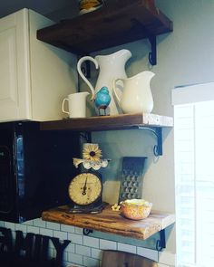 I love giving new life to old things.  The wood for my kitchen shelves came from the old deck we had to tear down because it was in such bad shape. Again it is decorated mostly with treasures I have found  at garage and estate sales. by rediscover_home